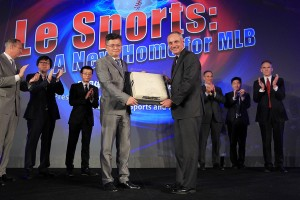 Le Sports Chairman Fei Gao presents Major League Baseball Commissioner Rob Manfred with a base that was used in the first MLB baseball exhibition game in China during the announcement of a partnership between Major League Baseball and Chinese sports network Le Sports Thursday, Jan. 6, 2016, at Caesars Palace in Las Vegas. Photo by Sam Morris
