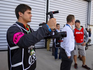 Clemson shot video using mostly DSLR cameras from Sony, Canon, and Nikon. Here, a student operator uses a Steadicam mount to capture smoother shots of the team entering the stadium.
