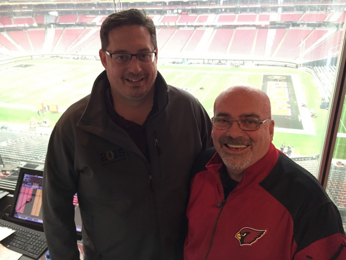 Bob Becker, SVP of Van Wagner Sports and Entertainment with Mike Conner, director of video board and event production for the Arizona Cardinals inside the video control room at University of Phoenix Stadium.