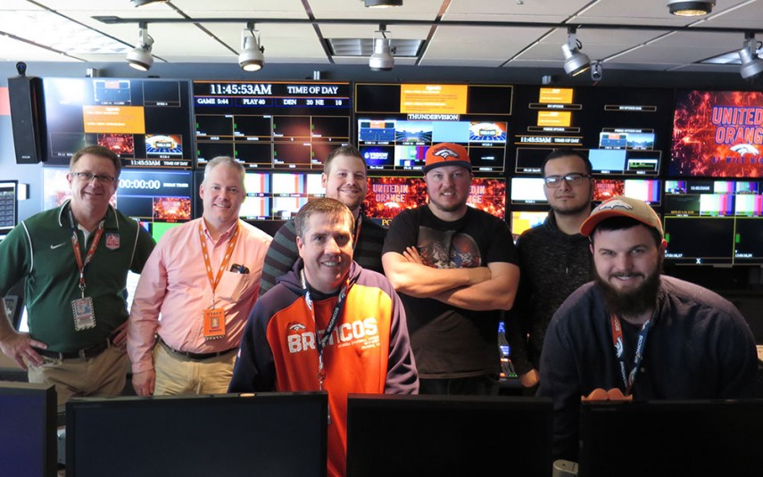 The Denver Broncos video staff inside the control room at Sports Authority Field at Mile High: (from left) Pat Jordan, Mike Bonner, Spencer Millard, Nick Young (front), Jeremy Wecker, Luis Miranda, and Aaron Gunning (front)
