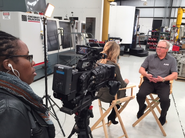 Veteran NHRA crew chief Alan Johnson being interviewed by Amanda Busick at his shop
