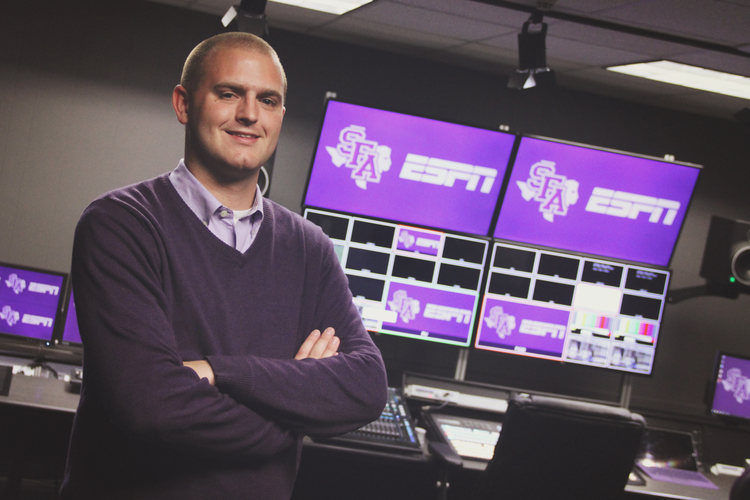 Korbin Pate, Stephen F. Austin's Coordinator of Athletic Video Productions inside the department's new centralized control room.