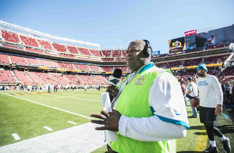 Mike Craft records content on the field at Levi's Stadium prior to Super Bowl 50.