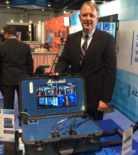 EVP of Sales Mark Lowden shows off the Azzurro TX portable transmission system in the company's booth.