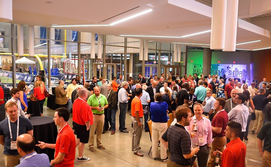 Attendees gathered at the Opening Night Reception at the College Football Hall of Fame.