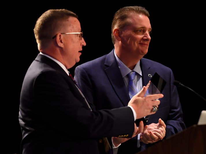 Michigan State University's Rich Church (left) presents the SVG College Sports Summit Pioneer Award to Nachtman.