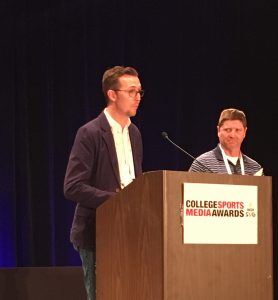 Texas A&M's Clay accepts the CSMA as Andy Richardson looks on