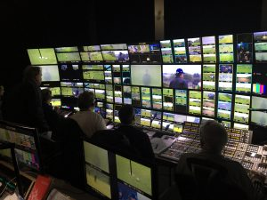 Working in a large cabin gives the NBC Sports production team plenty of space for a large monitor wall.