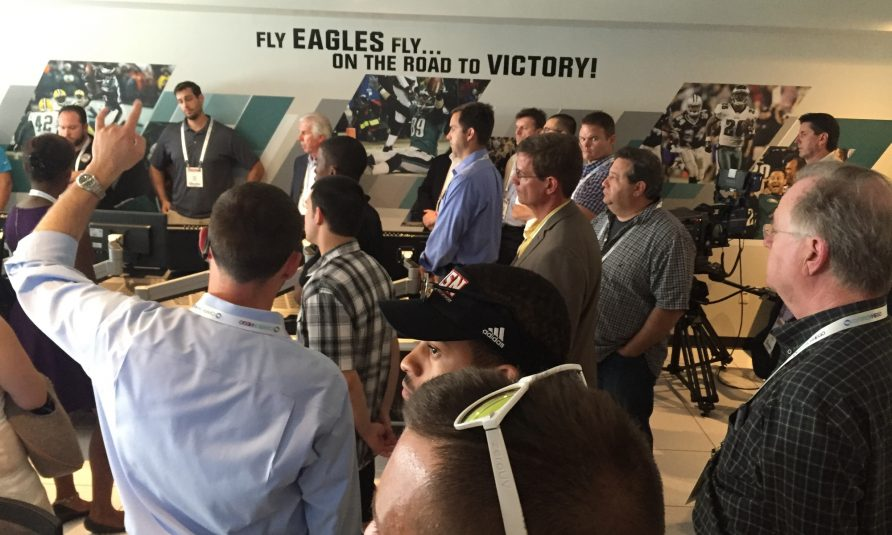 Eric Long (left) of the Philadelphia Eagles offers leads attendees through a tour of Lincoln Financial Field's video control room.