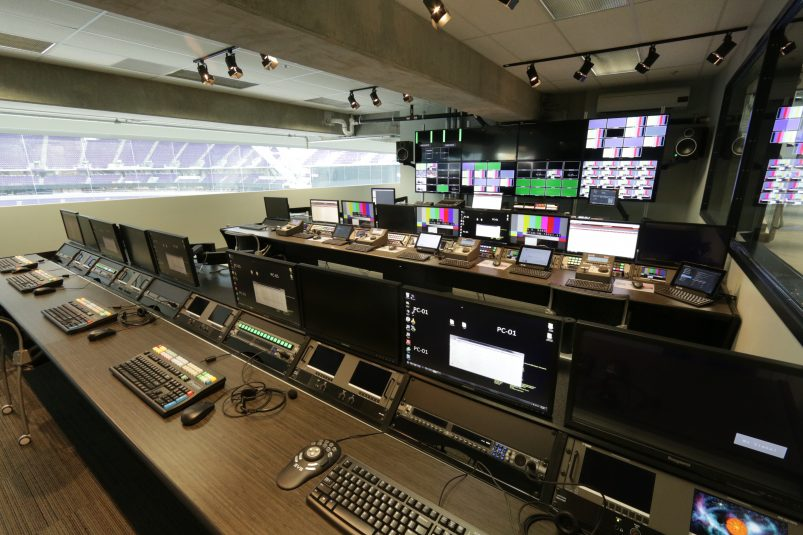 Inside the Vikings' video-control room. In addition to production personnel seated at the three benches, approximately 30 game-day staffers will be seated at the window overlooking the field.