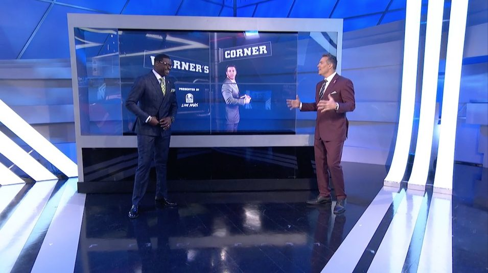NFL GameDay talent Michael Irvin (left) and Kurt Warner in front of a Planar LookThru OLED monitor
