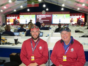 GoVision's Brett Ammon and Chris Curtis in front of the massive LED board inside the Ryder Cup Media Center.