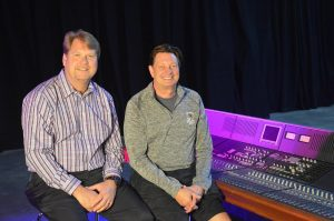Kirt Hamm (left) and Fred Aldous with a Calrec console that was donated to CRAS by Game Creek Video. It will help train the next generation of audio mixers.