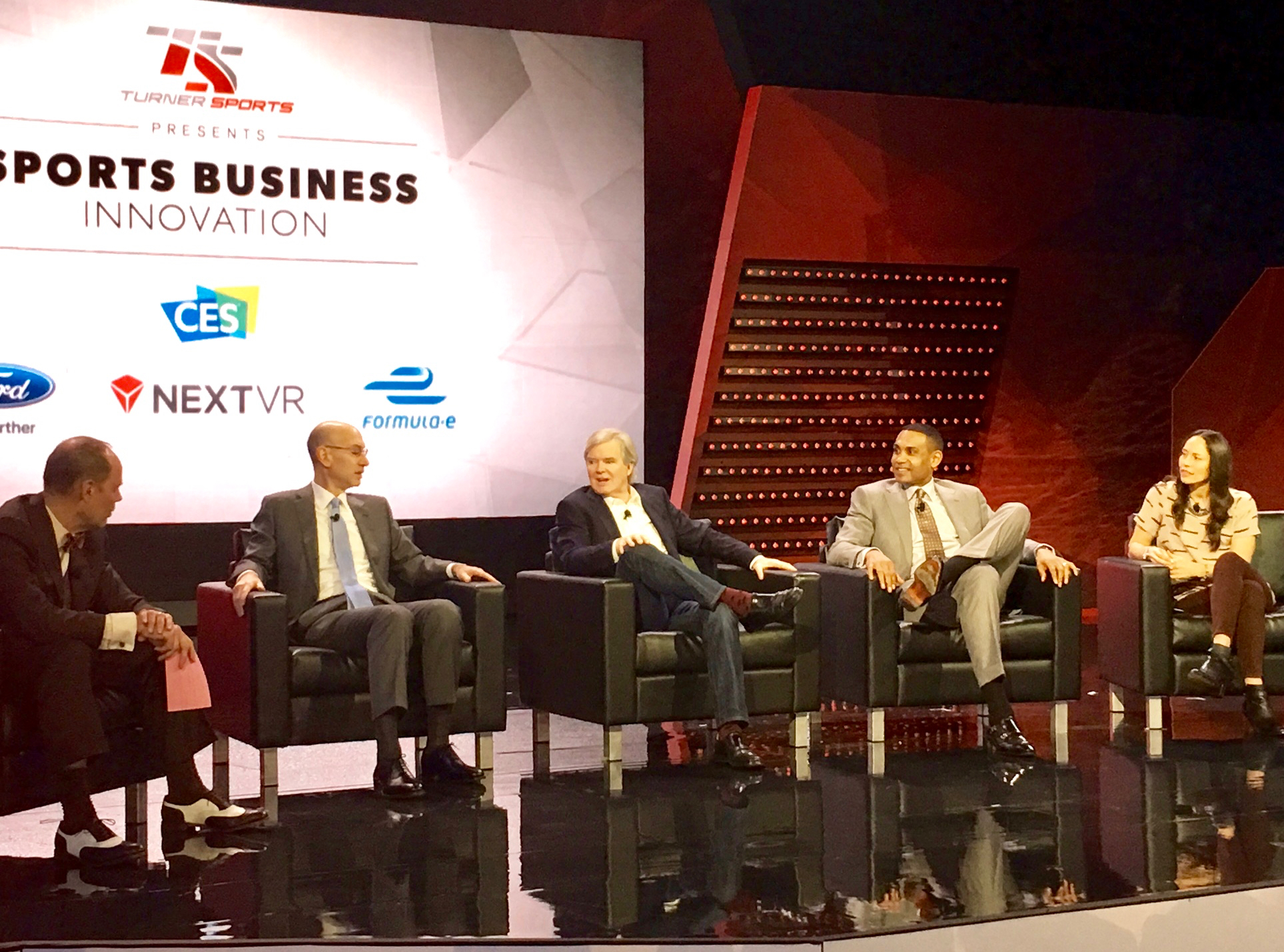 TNT's Ernie Johnson (left) moderated a panel that discussed social media and more at CES. It featured (l-to-r) Adam Silver of the NBA, Dr. Mark Emmert of the NCAA, Grant Hill of TNT/NBA TV, and Sue Bird of the Seattle Storm.