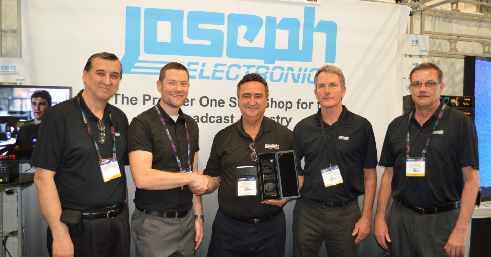 Joseph Electronics' President and CEO Yohay Hahamy (center) , along with other members of the JE family, accepts the award for Distributor of the Year from DirectOut.