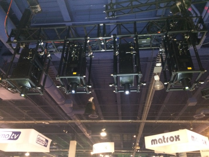 Four Boxer 2K30 projectors were installed above the booth for the mapping demo.