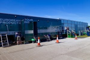 The Open Championship compound features plenty of CTV OB production trucks as well as a large broadcast center (right).
