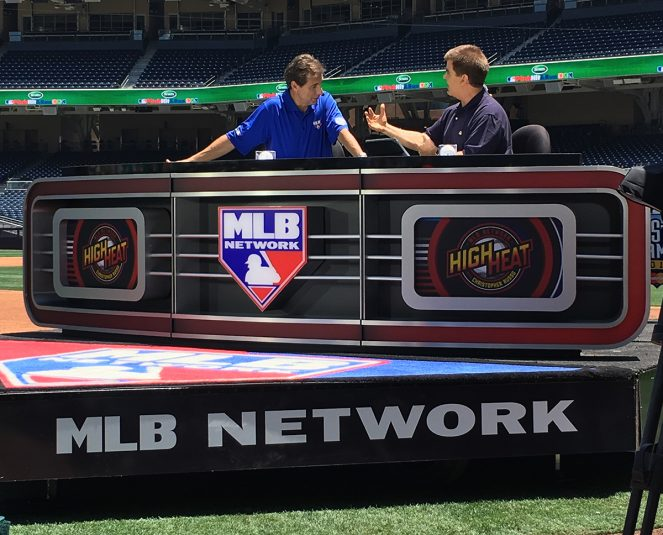 MLB Network primary set, which is wheeled on and off the field on a golf cart, is on the third-base line.