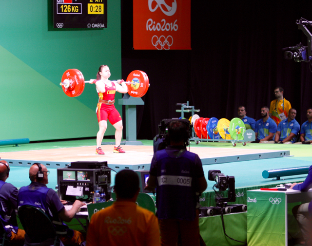 Communications among officials at events like weightlifting relies on a number of technologies from Riedel Communications.