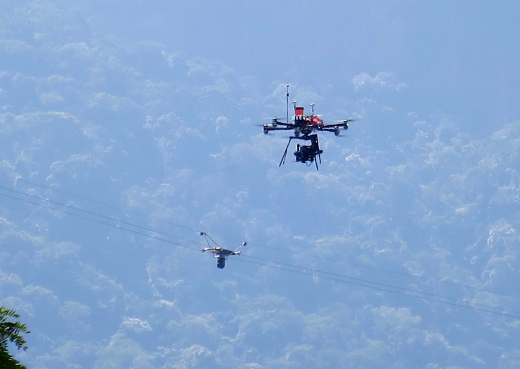 The rowing events at the Olympics have two forms of aerial coverage: a Camcat cable cam and a drone.