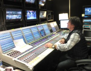 Peteris Saltans, freelance audio mixer for NFL Network, at work on a Calrec Artemis console.