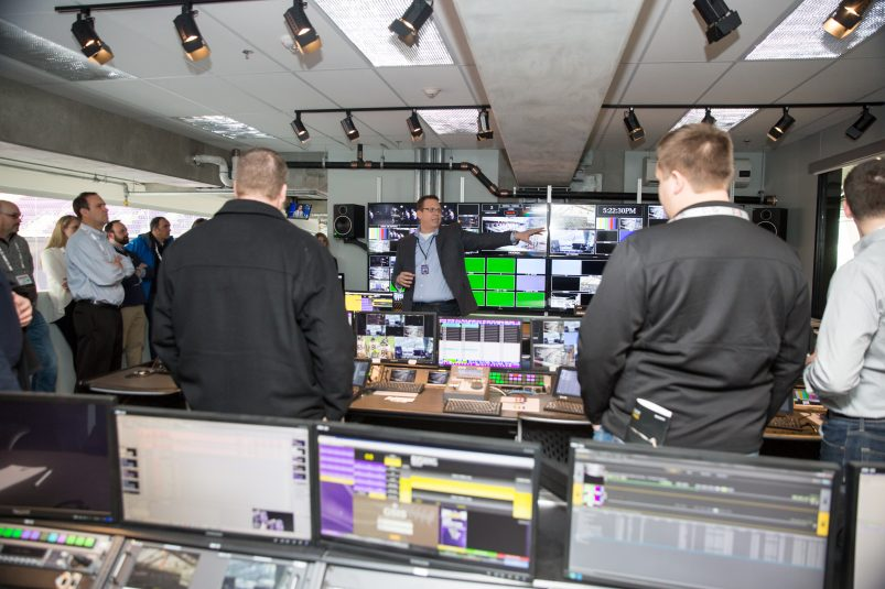 Alpha Video's Brian Beckwith, broadcast design engineer, explains the inner workings of the U.S. Bank Stadium video-control room to event attendees.